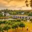 Brug-over-de-rivier-de-Dordogne-in-de-herfst