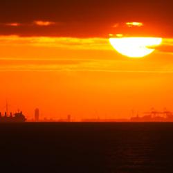 zonsondergang en de haven