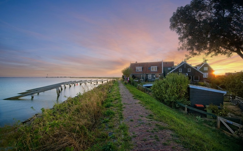 Sunset at Marken Icebreakers - This is the famous Marken, north of Amsterdam in Netherlands. The location is known for its beautiful sun-rises and sun