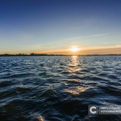 Zonsopkomst boven de uiterwaarden van de IJssel