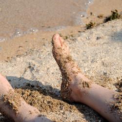 Voetjes in het zand