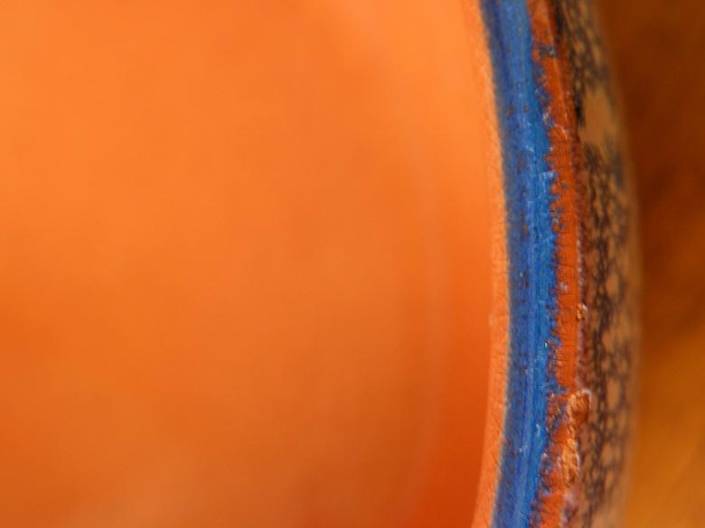 Oranje - Goed kijken, dan zie je de rand van een schaaltje