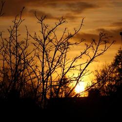Zonsondergang vanuit dakraam