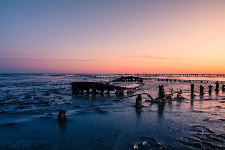 Scheepswrak Wierum - Het welbekende scheepswrak in een winters landschap nabij Wierum