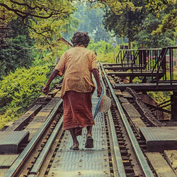 Old lady crossing bridge river kwai