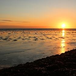 zonsondergang aan de zeedijk