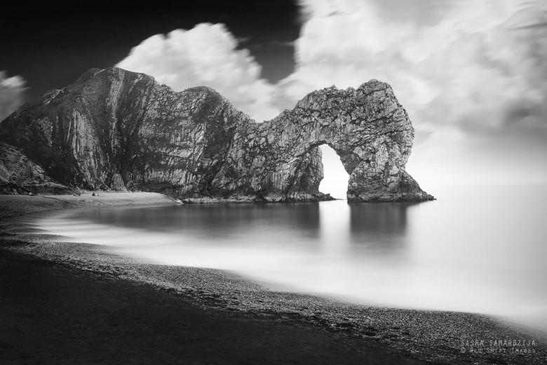 Durdle Door - Durdle Door monochrome on Jurassic coastline in Dorset, United Kingdom