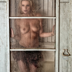 behind dirty glass