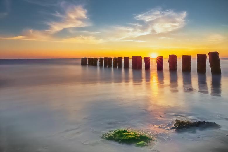 The Beautiful and Treacherous Sea - De zee geeft, de zee neemt.<br />  Foto gemaakt op Ameland, een golfbreker bij Hollum.<br />