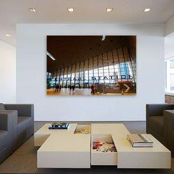 Je eigen foto aan de muur in kantoortuin.