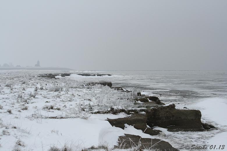Winters zicht op Wierum  - Vanmiddag even genoten van het prachtige winterse landschap aan de zeedijk bij Wierum