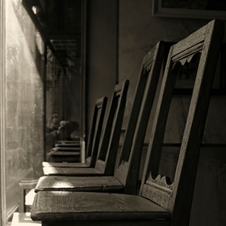 we have become empty spectators on old chairs behind a vintage window