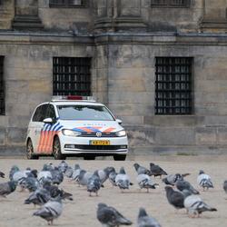 Politiewagen op de Dam