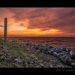 Sunset op de pier van Stavoren
