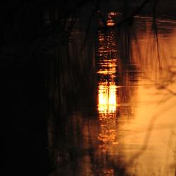 Spiegel van de ondergaande zon