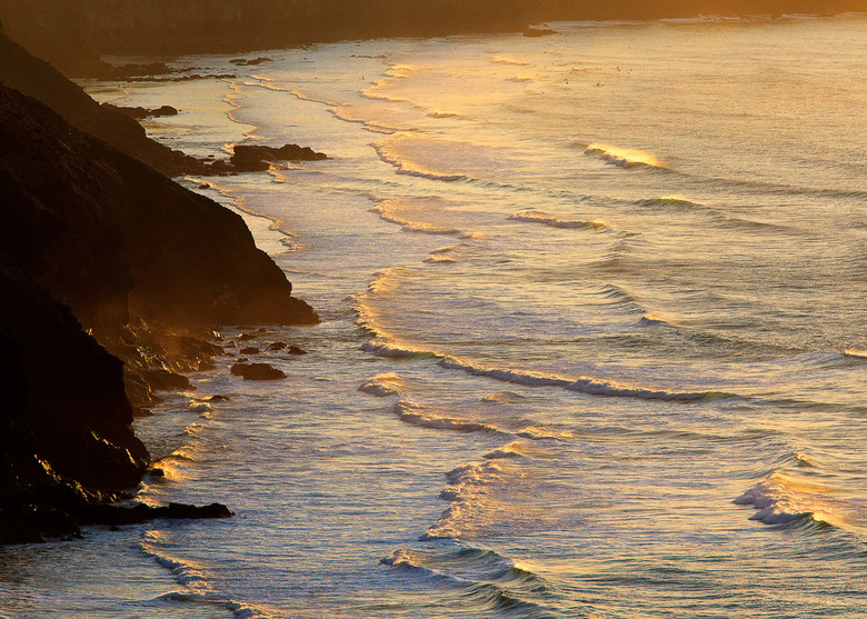 Surf's up! - Warming glow of the evening light illuminating the waves