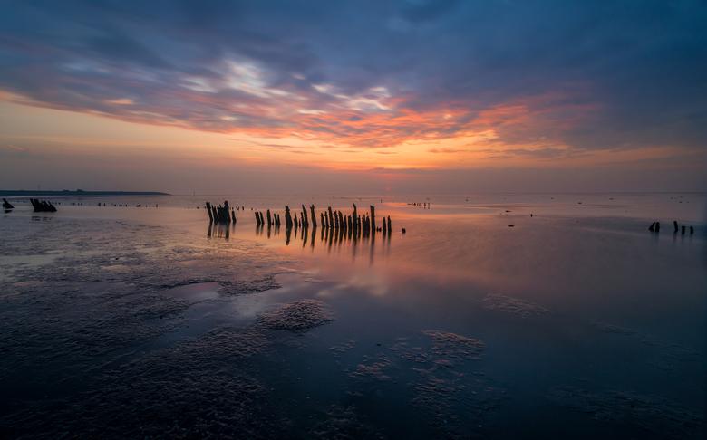 Moddergat bij zonsondergang