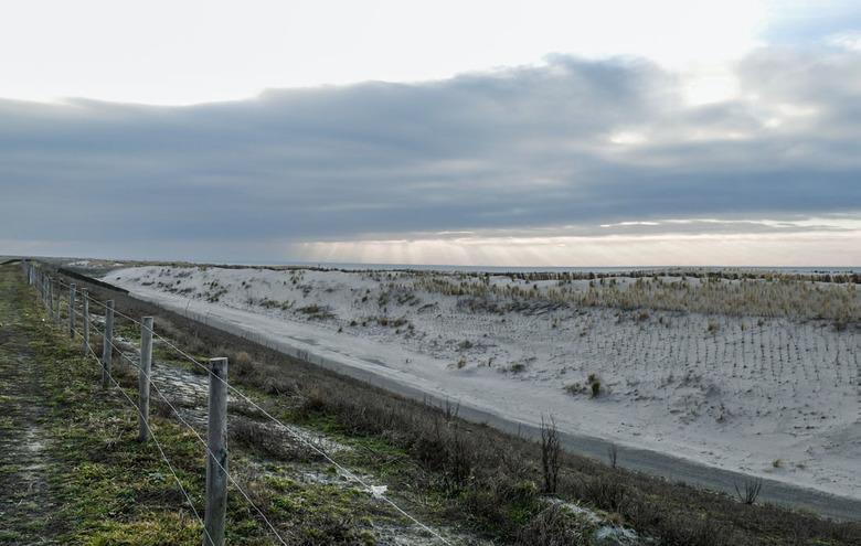 Dijk - Het begin van de Honsbossche zeewering nabij Petten