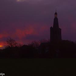 de knoptoren in het ochtend rood