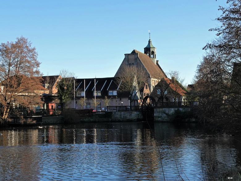 Oude watermolen - Zicht op de oude watermolen in Neuenhaus. Neuenhaus is gelegen in Grafschaft Bentheim in Nedersaksen. De watermolen is voor het eers