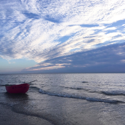 wolken boven zee