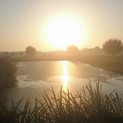Fietsend genomen foto van zonsopkomst. ll