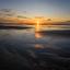 Strand zon onder