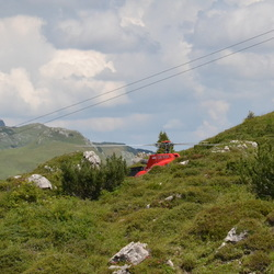 Helicopter behind the mountan
