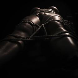 Nude in bondage