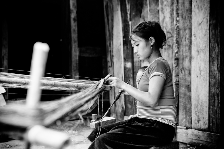 Hemp spinning girl in Sapa, Vietnam