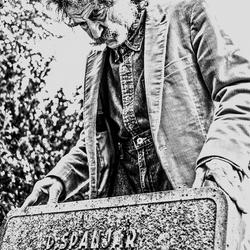 man visits grave parents.jpg