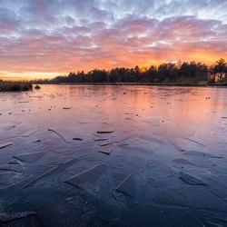 Zonsondergang over het ijs