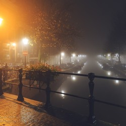 Amsterdam foggy canal light