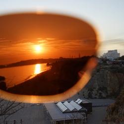 De zonsondergang gezien door mijn zonnebril