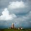 Bewolking boven de vuurtoren van Texel