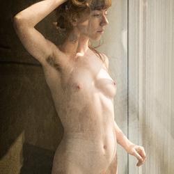 sunlight through a soiled window pane
