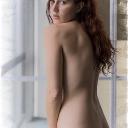 behind a window pane