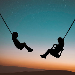Brother and sister swinging
