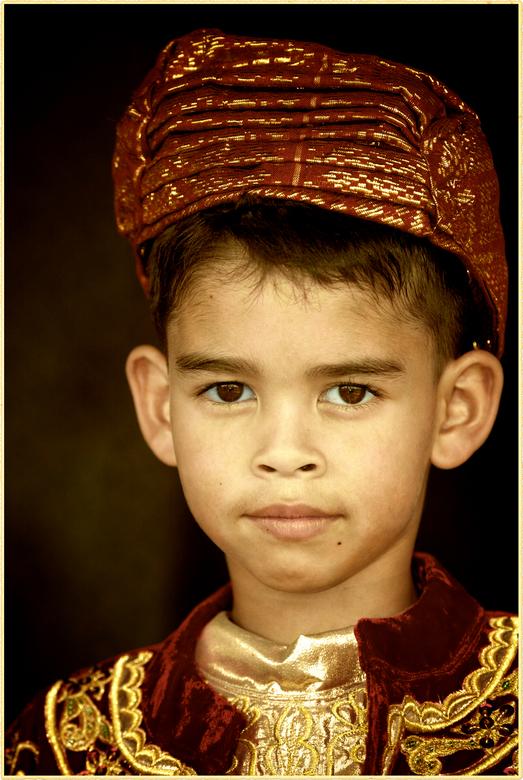 Minangkabau - Mijn zoon tijdens een traditionele minangkabau ceremonie in Padang, Indonesie.