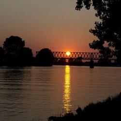Ondergaande zon Maas
