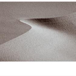 de wind speelt met zand 13