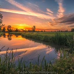 Zonsopkomst over een typisch Hollands landschap