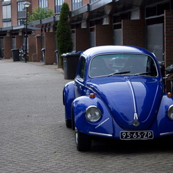 Old blue beetle in Modern street