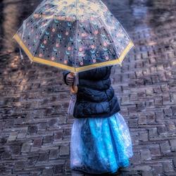 Little princess in the rain.