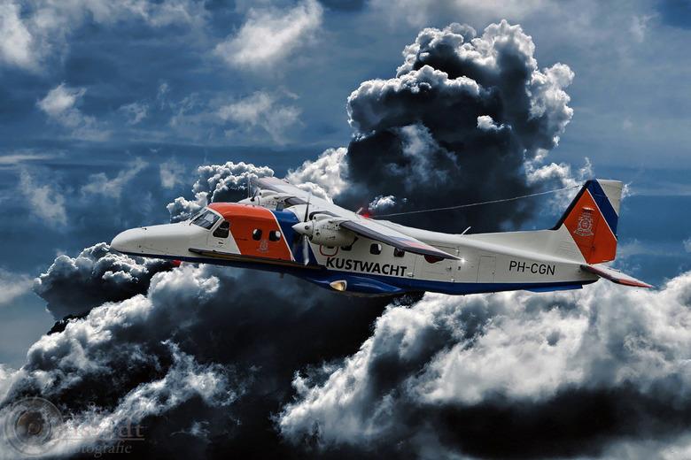 Coastguard with a storm cloud -