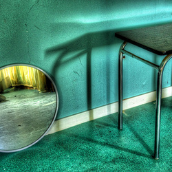 the mirror and little table