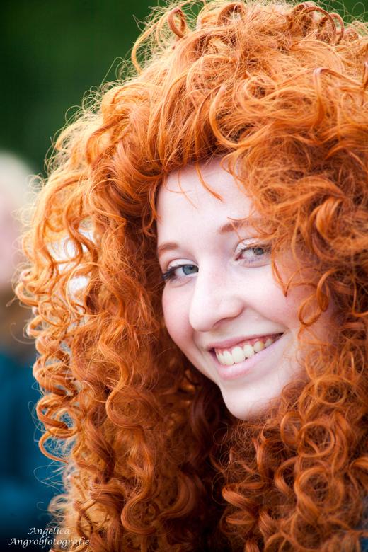 Foto Fair - Mooi meisje met prachtige rode haren.