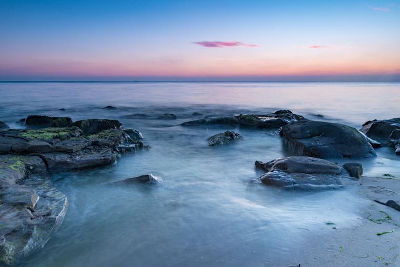 enjoy - Zonsondergang op een strandje aan de Opaalkust