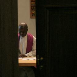 Priest at work
