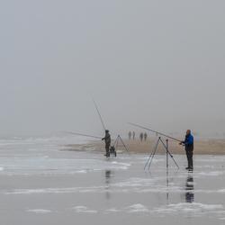 Vissers aan de kust